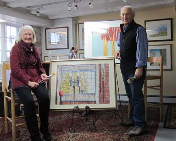 Judy Quinn and Andrew Kusmin pose with examples of their work